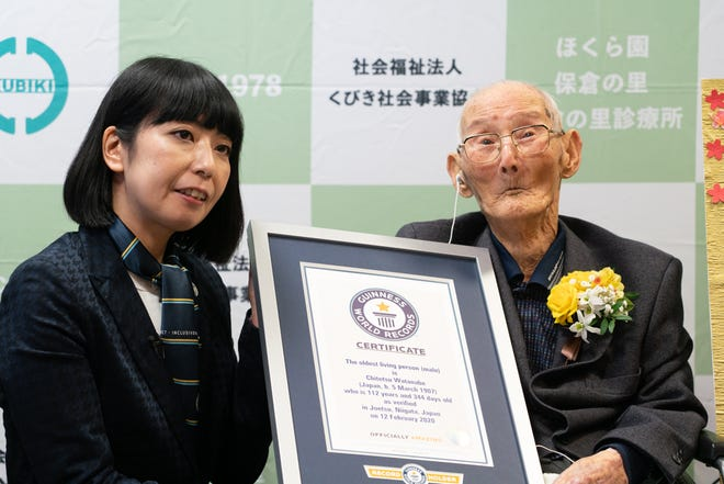 Chitetsu Watanabe, 112, is presented a certificate by Guinness World Records' Kaoru Ishikawa at his nursing home in Niigata, Japan, his hometown. usatoday.com